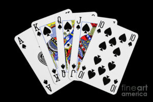 playing-cards-royal-flush-on-black-background-natalie-kinnear